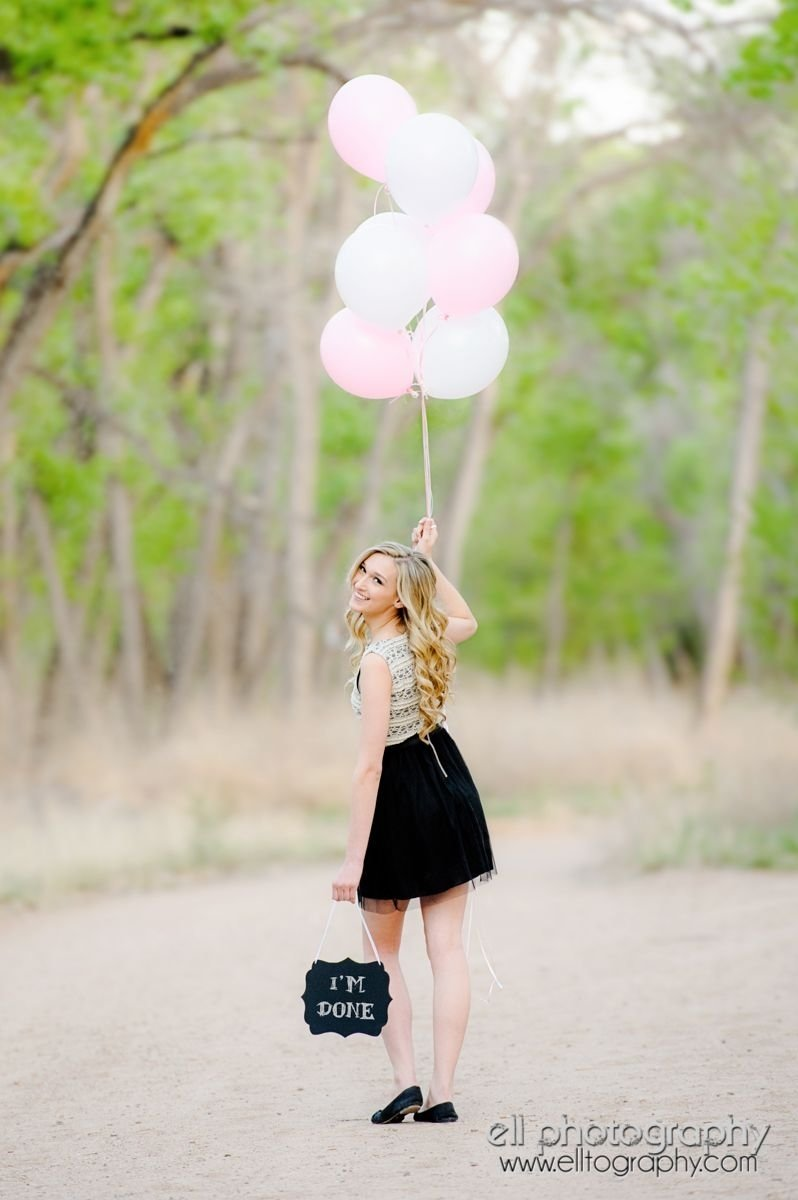 super cute outdoor graduating senior photo with balloons and chalk