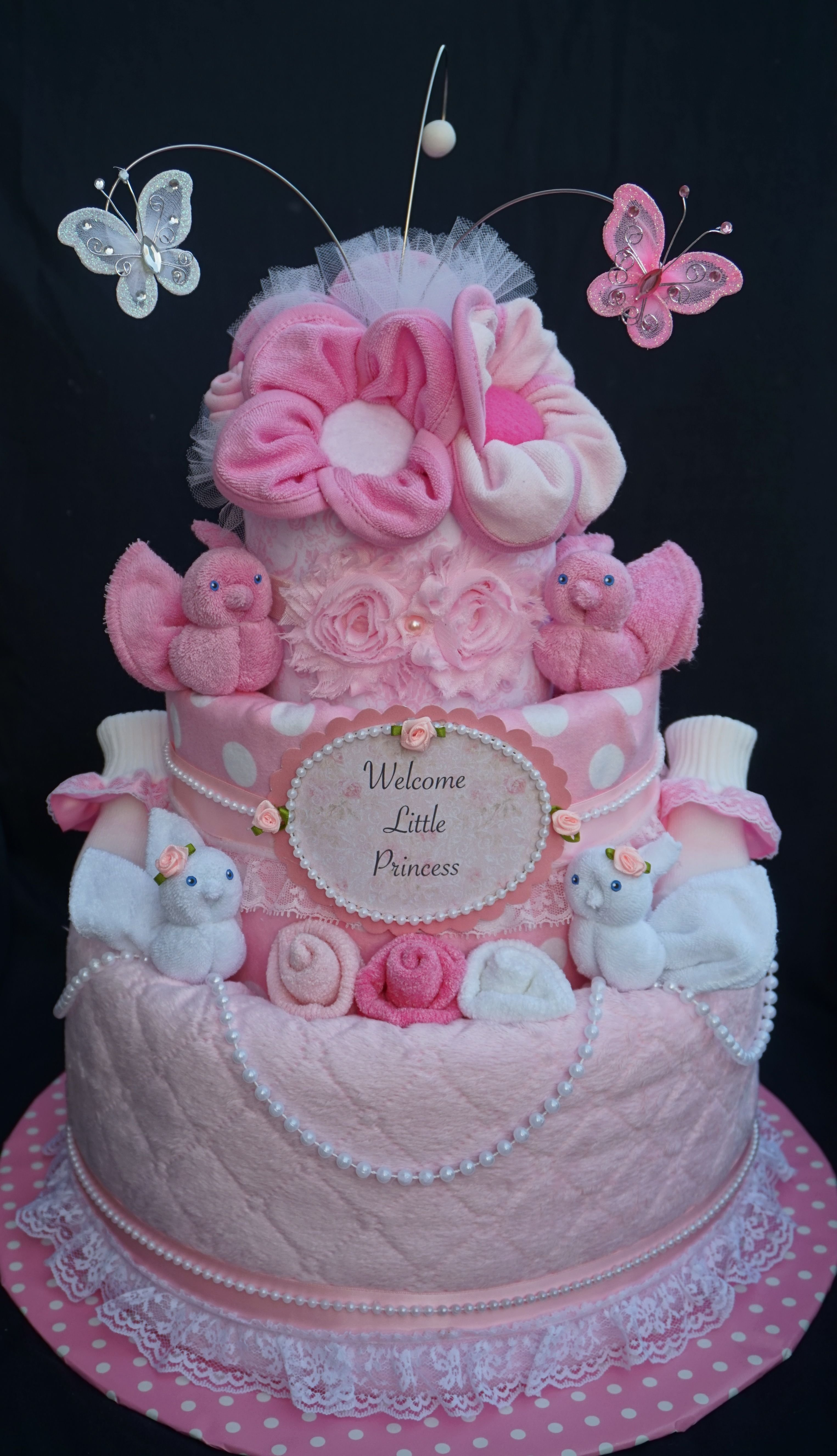 10 Awesome Diaper Cake Ideas For A Girl sweet baby girl diaper cake www facebook diapercakesbydiana 2 2020
