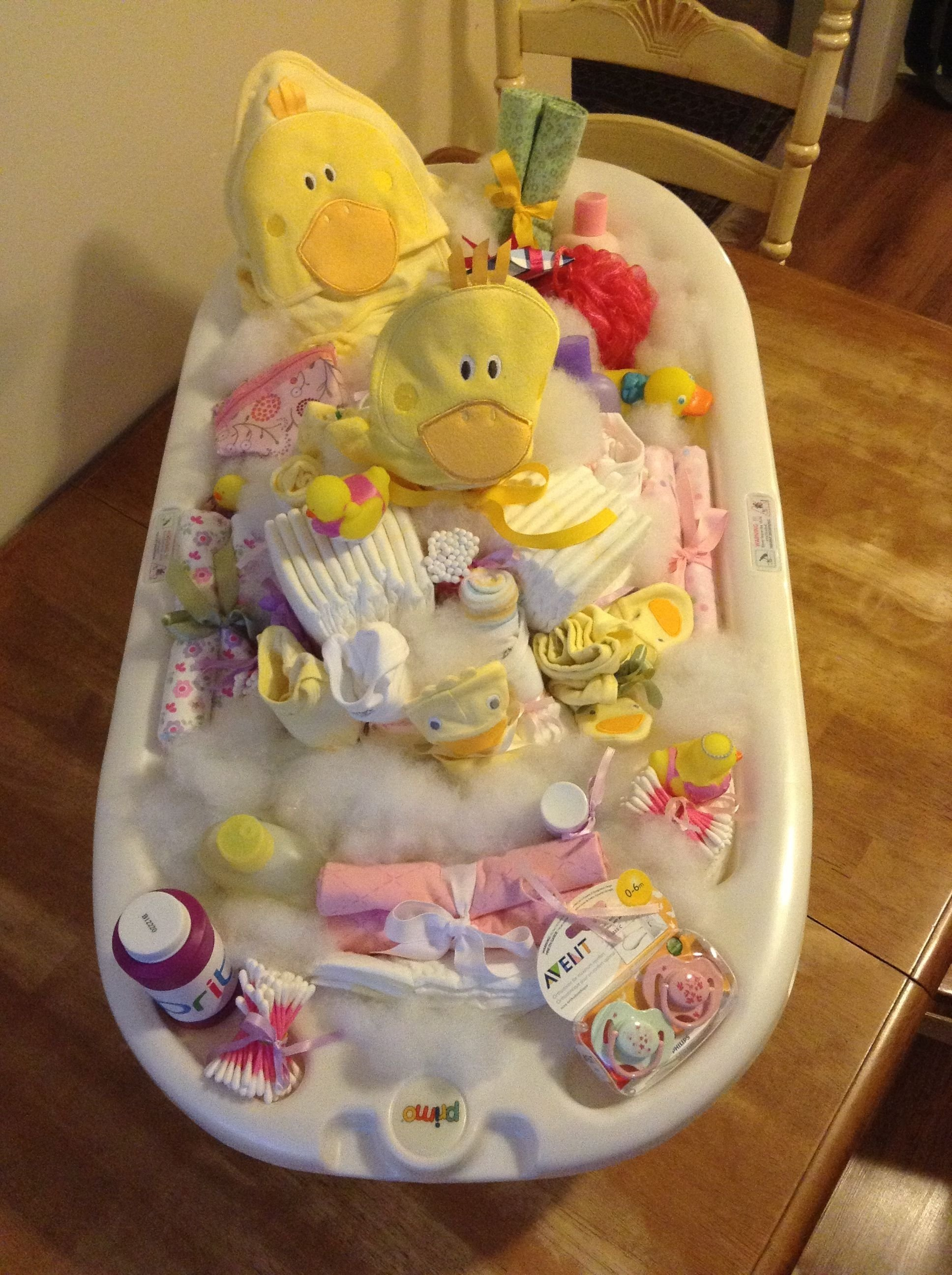 10 Stylish Homemade Baby Shower Gift Ideas sweet baby shower gift the base of the tub is filled with diapers 1 2021