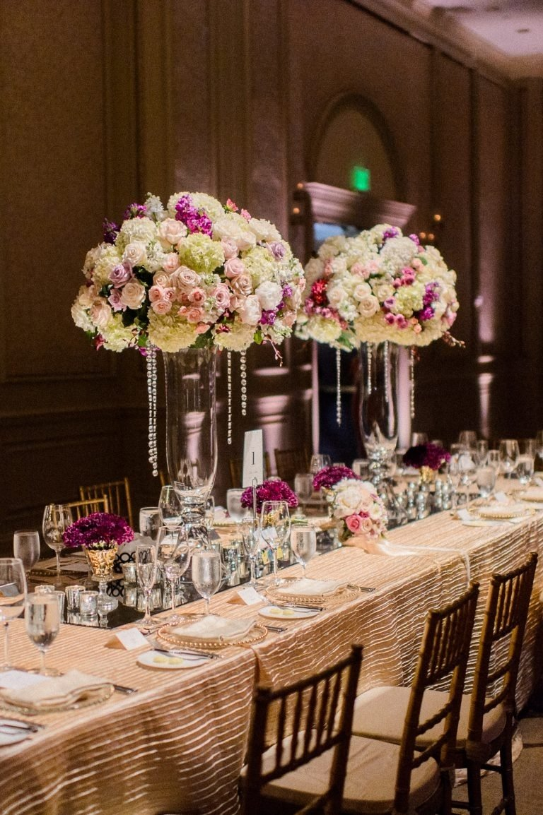 10 Fantastic Pink And Brown Wedding Ideas tall wedding centerpiece crystal flower arrangements kings table 2021