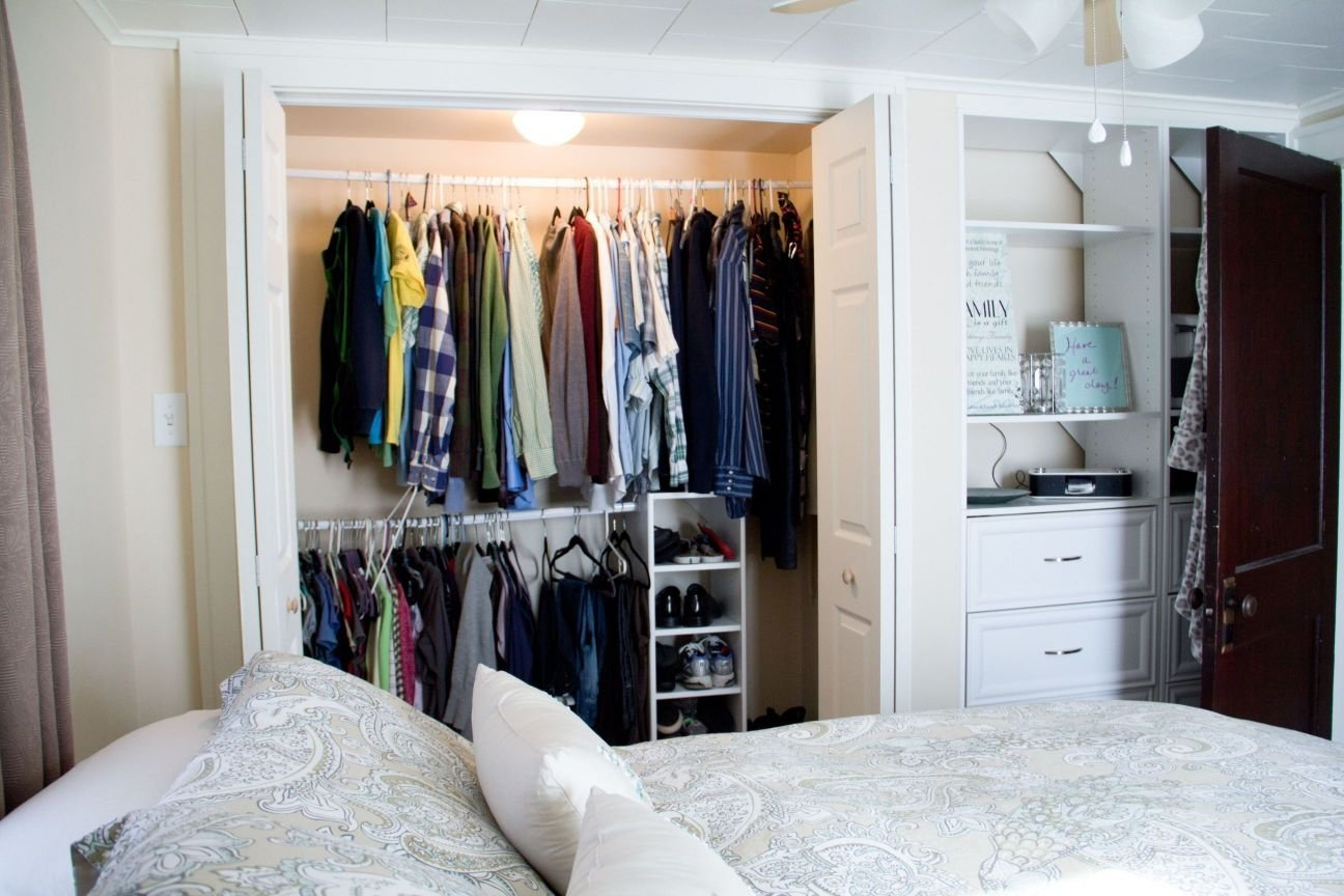 the best white closet bedroom with doors near bed and pillows