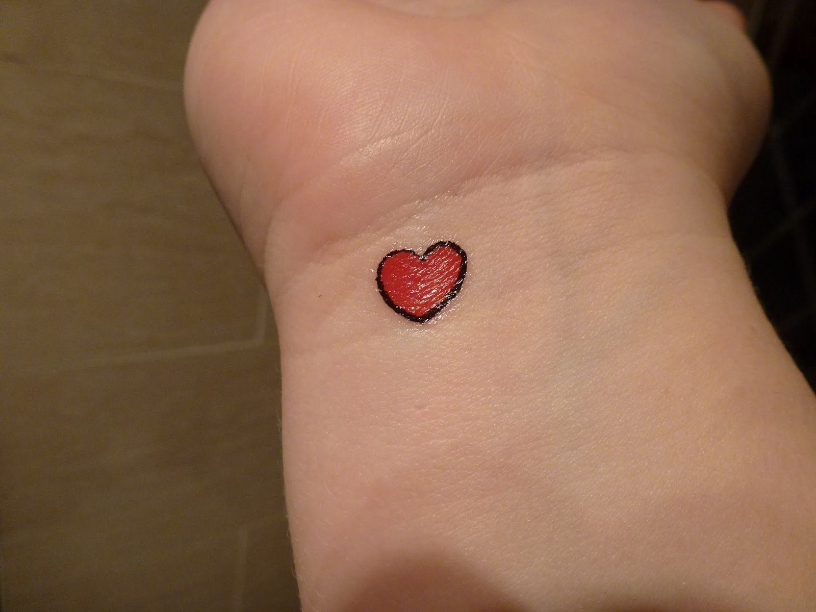 10 Stylish Heart Tattoo Cover Up Ideas tiny red heart tattoo on wrist 2020