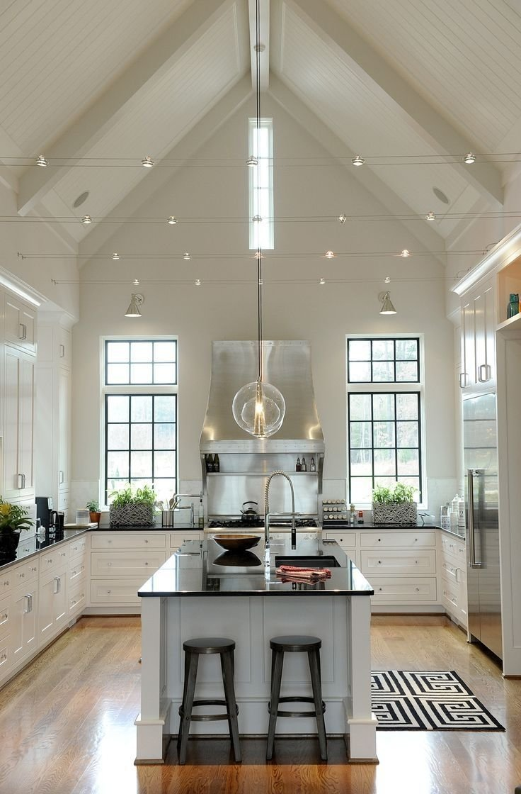 10 Trendy Lighting Ideas For Vaulted Ceilings track lighting installed to wash the vaulted ceiling with light and 2020