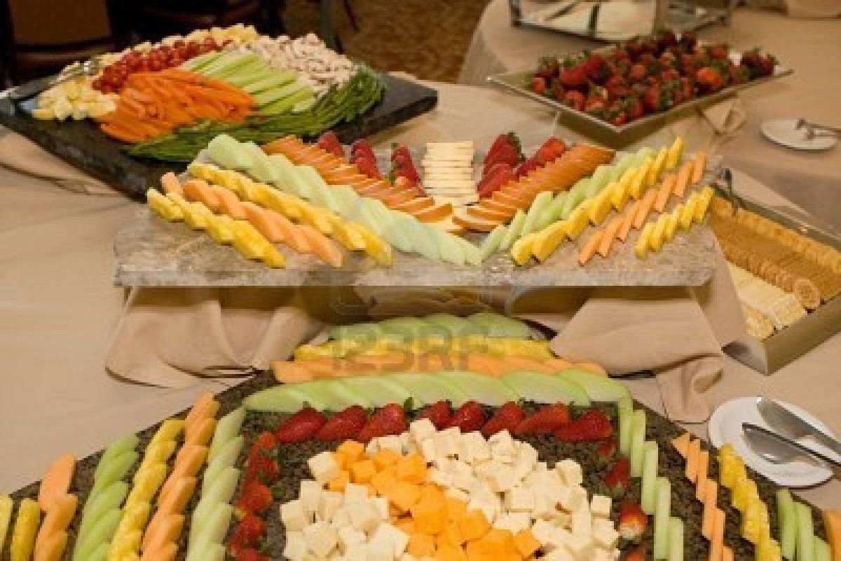 10 Fantastic Cheese And Cracker Tray Ideas trays of fruit cheese vegetables and crackers are displayed at the