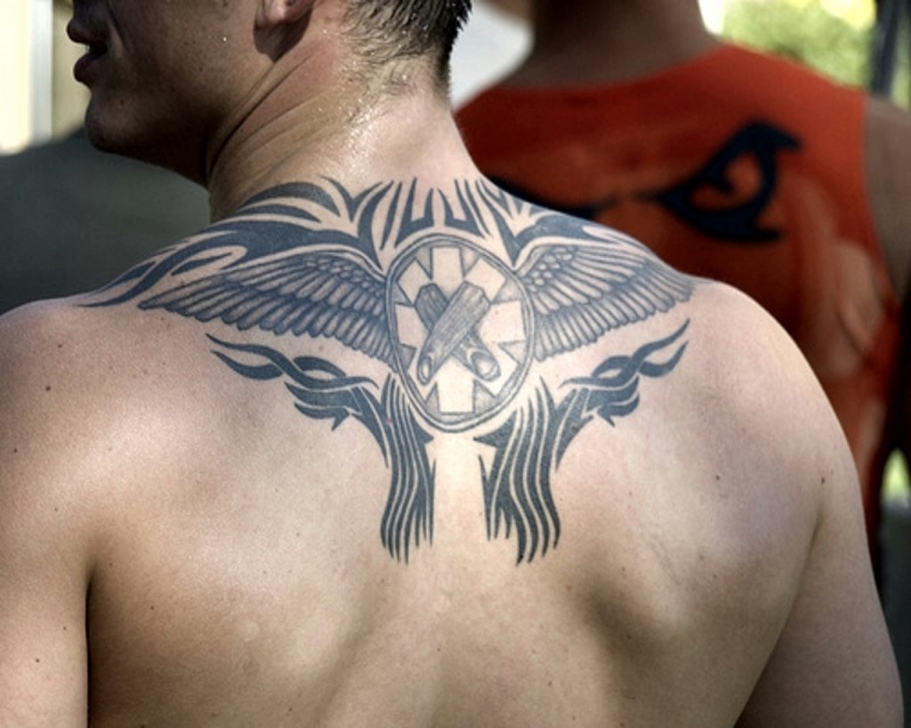 10 Fantastic Back Tattoo Ideas For Guys tribal back tattoos for guys back tribal tattoos for guys tumblr 2021