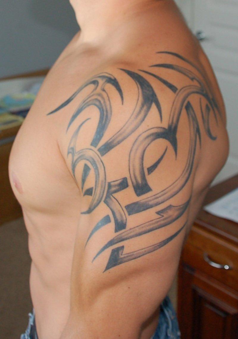10 Lovable Shoulder Tattoo Ideas For Men tribal shoulder tattoo art for men tattoomagz 2021