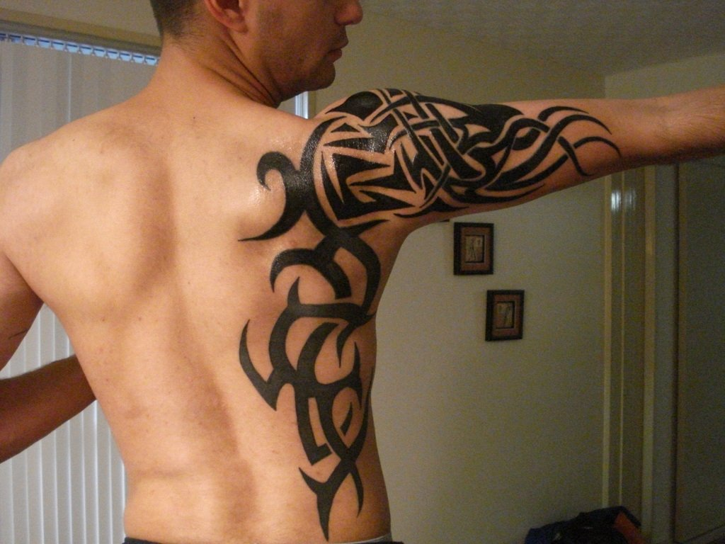 10 Stunning Cool Tattoos Ideas For Guys tribal tattoo ideas toycyte 1 2020