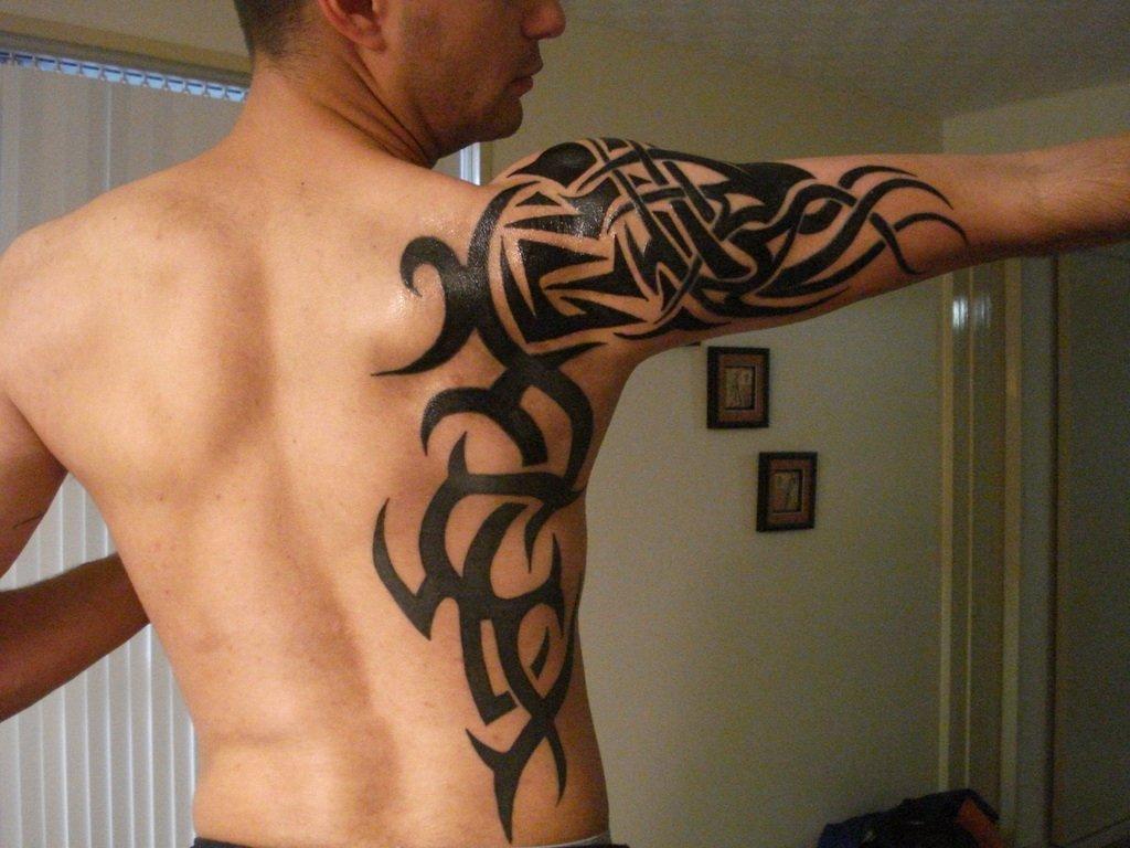 10 Stylish Tribal Tattoo Ideas For Guys tribal tattoo ideas toycyte 2020
