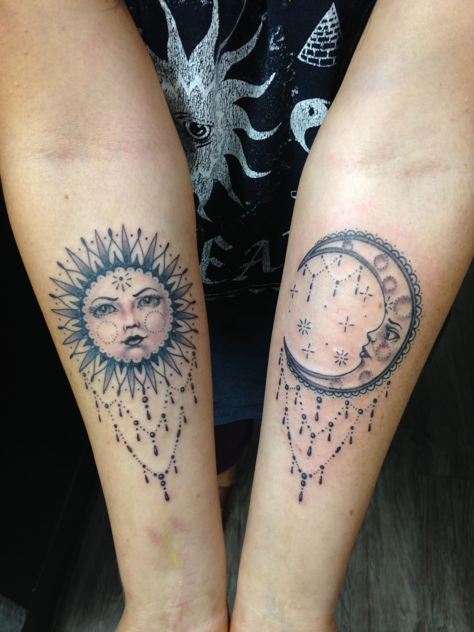 10 Awesome Sun And Moon Tattoo Ideas unique dotwork sun and half moon tattoo on both forearm 2020