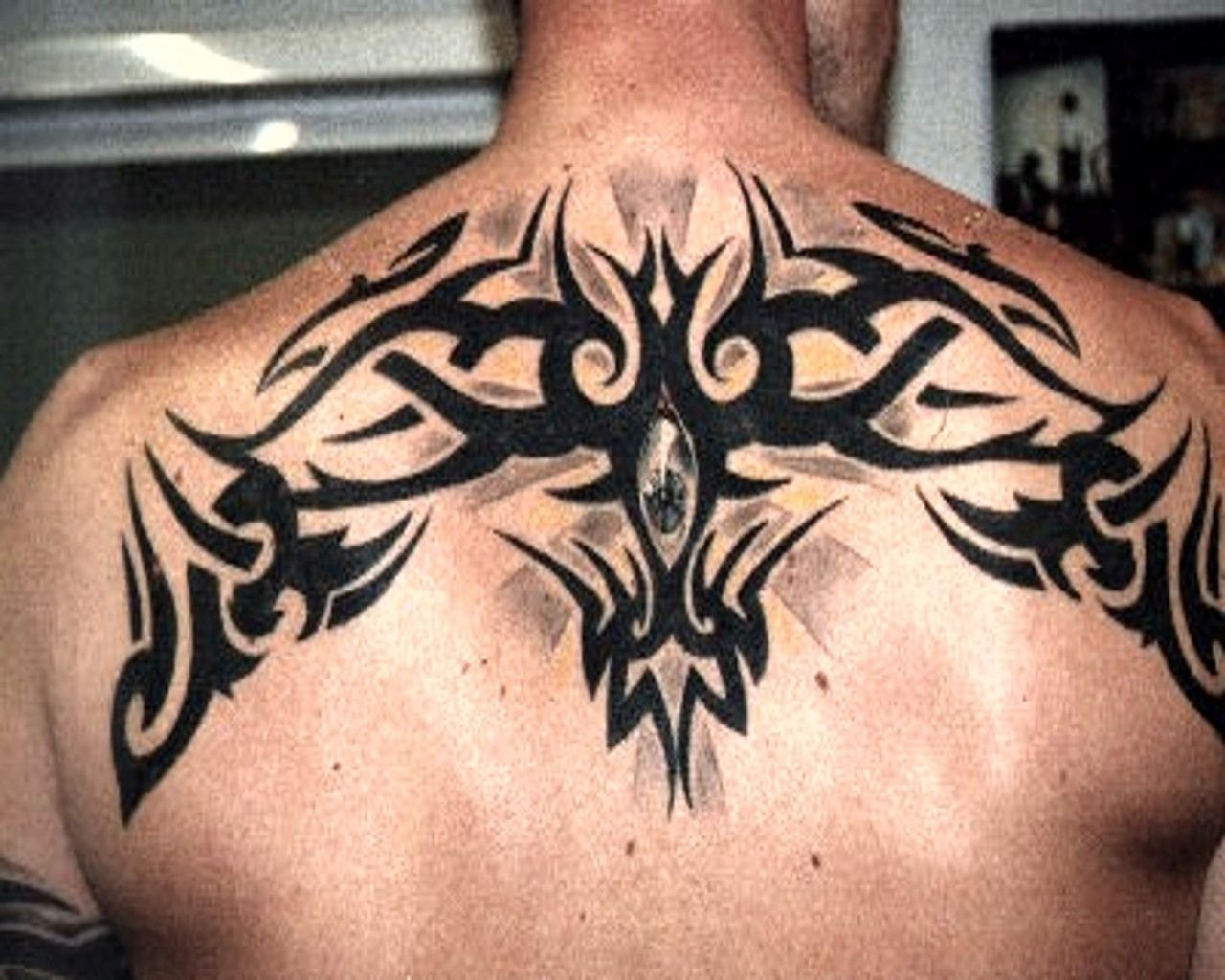 10 Fantastic Back Tattoo Ideas For Guys upper back celtic design tattoos pinterest tattoo mens 2021