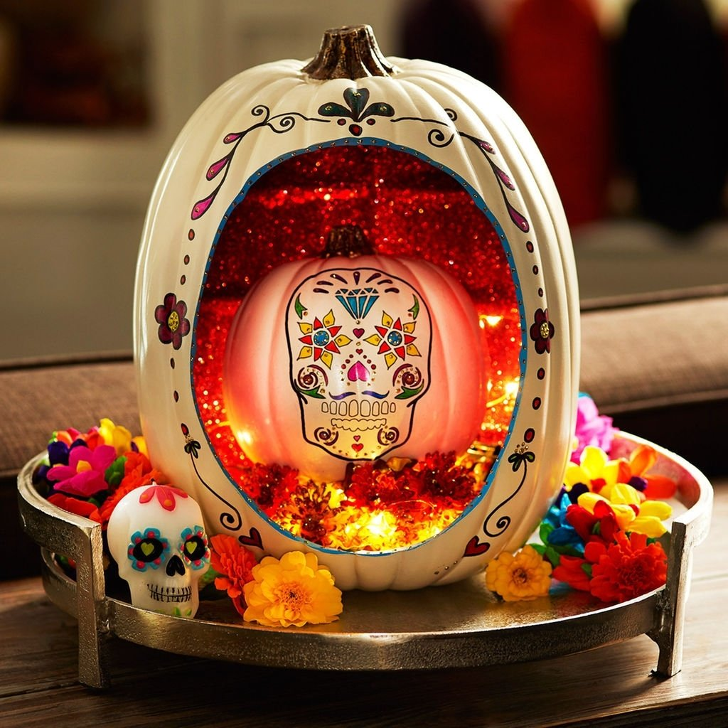 10 Famous Day Of The Dead Craft Ideas use a craft pumpkin to create this fabulous day of the dead pumpkin