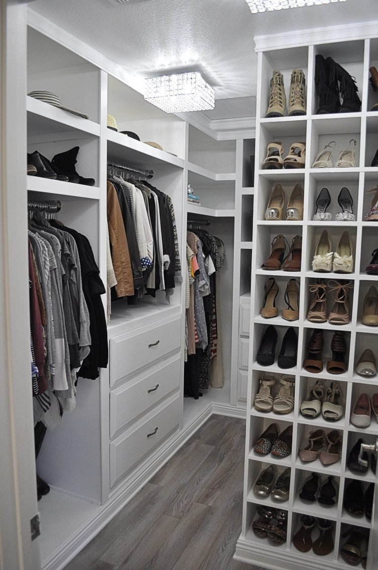 10 Stylish Small Walk In Closet Ideas very well organized walk in closet with white cabinets and storage 3 2021