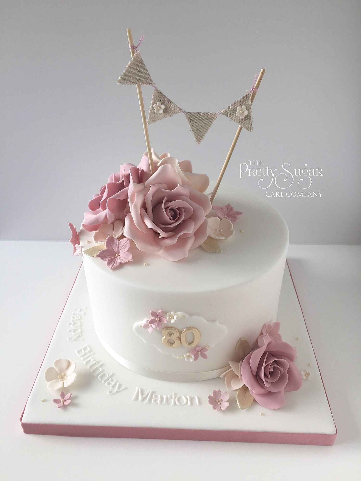 10 Awesome Birthday Cake Ideas For Women vintage style 80th birthday cake with sugar roses and bunting topper 2020