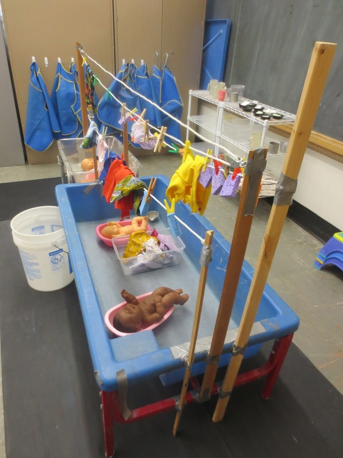 10 Lovely Sand And Water Table Ideas washing doll clothes and hanging them up to dry links to the 2020