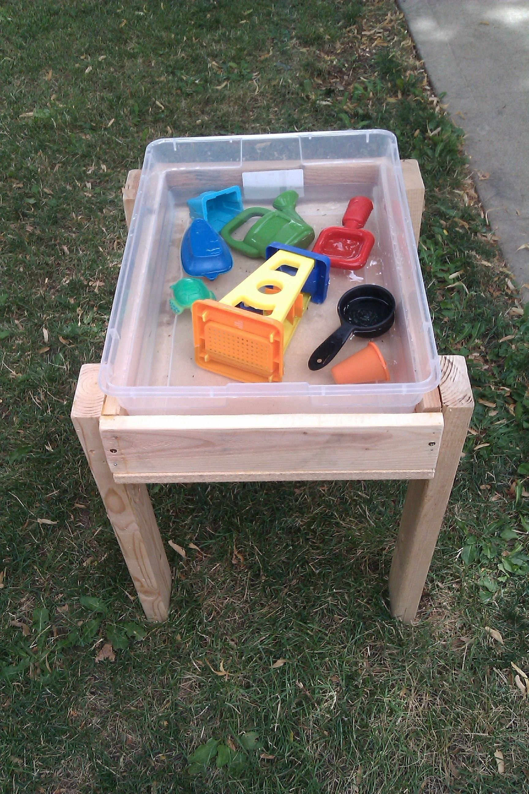 10 Lovely Sand And Water Table Ideas water table idea easy to clean and stores toys for winter kids 2020