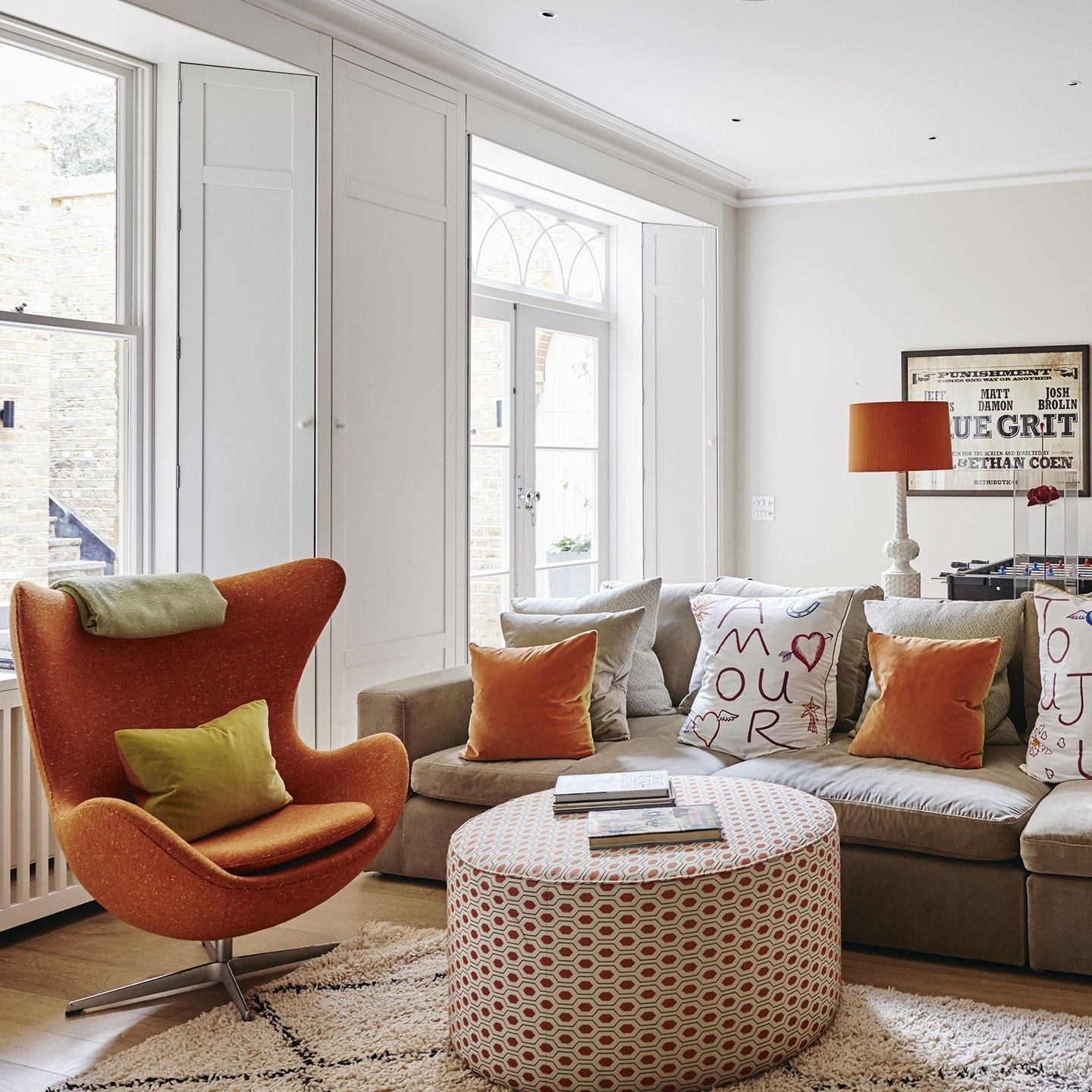 10 Stylish Living Room Color Scheme Ideas white living room with orange accents 1