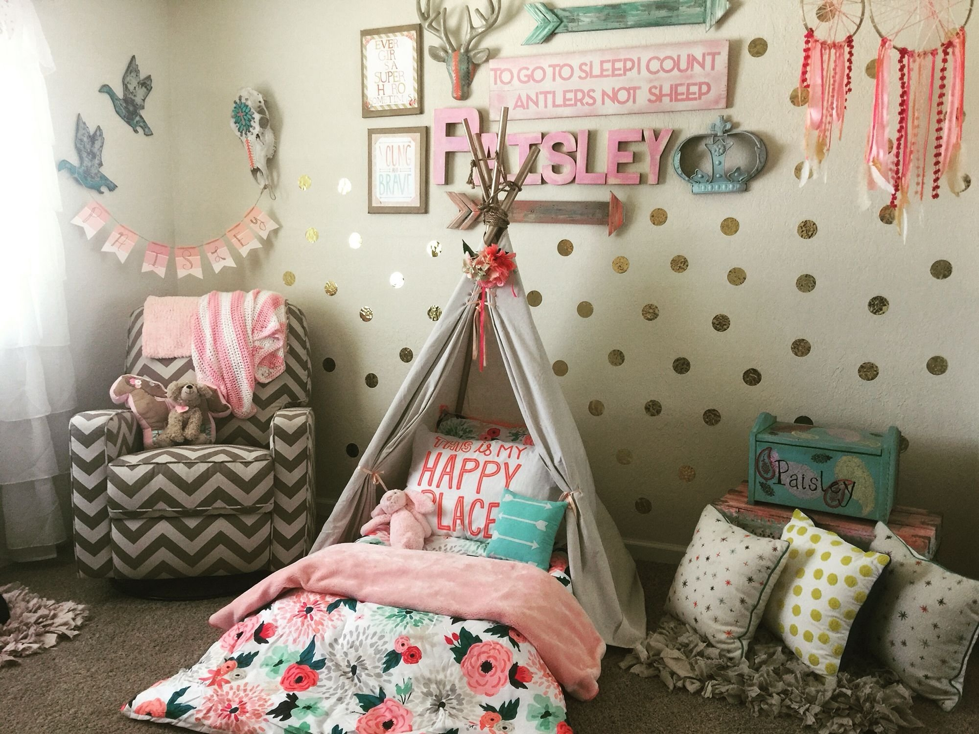 wild and free toddler room. tee pee montessori bed on the floor