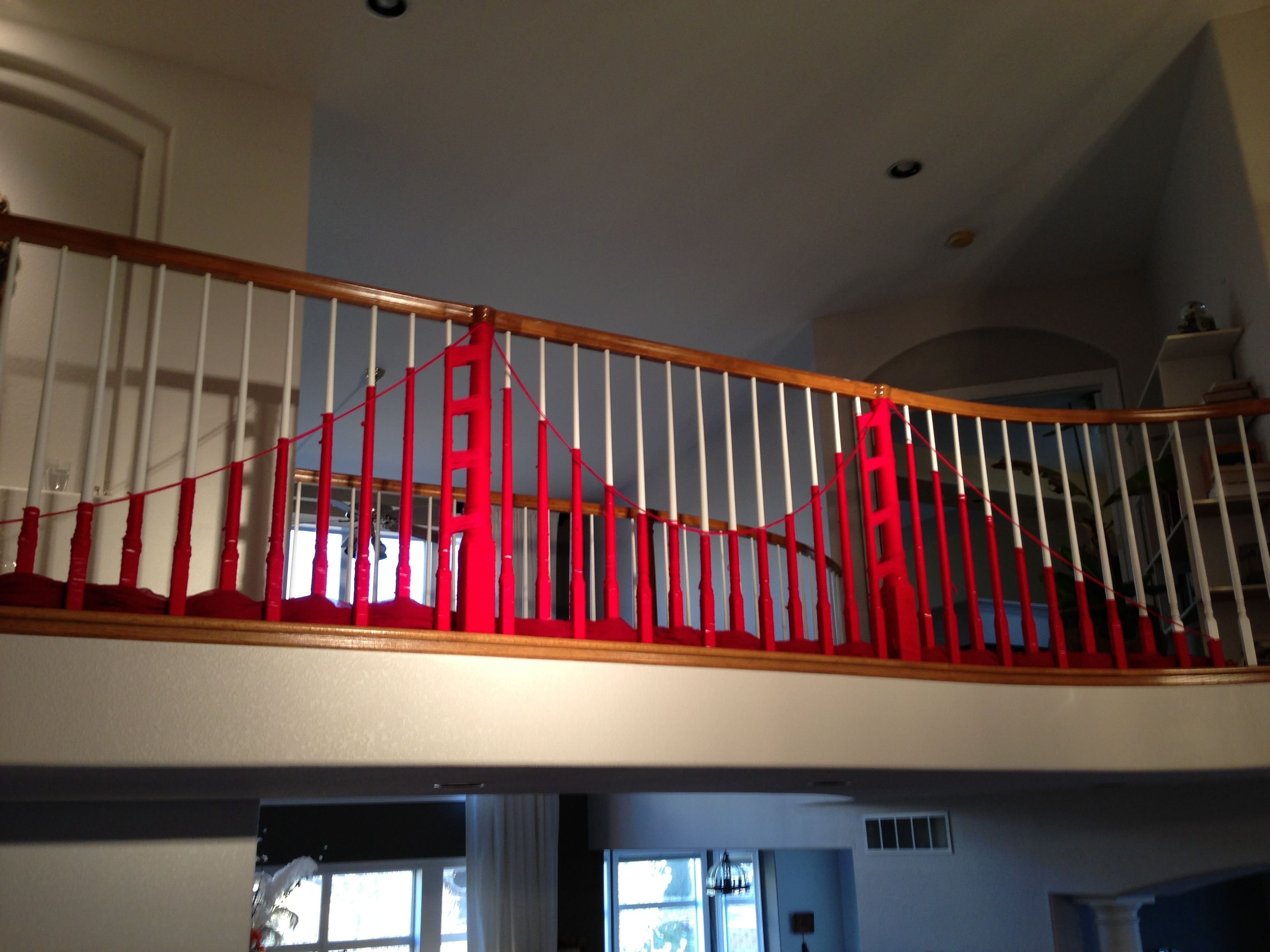 yarn bombing your banister for a san francisco themed party. | arts